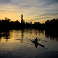 Man rowing on the yarra river melbourne city view with Royalty Free Stock Photo
