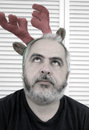 Man in rudolph costume Stock Image