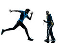 Man runner sprinter with coach stopwatch silhouette Royalty Free Stock Photo