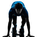 Man runner sprinter on starting blocks silhouette one caucasian in studio isolated white background Stock Image