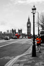 Man running across bridge a picture of a westminster with the iconic big ben clock in the background a great picture to Royalty Free Stock Photo