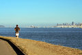 Man running away near tiburon california behind san francisco s skyline Stock Photos