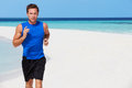 Man running on beautiful beach happy Royalty Free Stock Photo