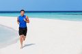 Man running on beautiful beach happy Royalty Free Stock Image
