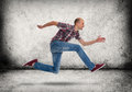 Man running gray concrete wall and floor Royalty Free Stock Photo