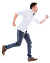 Man running late casual isolated over a white background Royalty Free Stock Photo