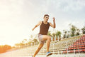 Man running on a racing track Royalty Free Stock Photo