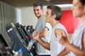 Man running on treadmill in fitness club portrait of happy mature men Royalty Free Stock Photography
