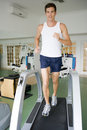 Man Running On Treadmill At Gym Royalty Free Stock Photos
