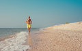 Man runs on the sea surf line Royalty Free Stock Photo