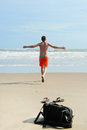 Man runs into the sea young to swim Stock Photography