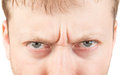 Man's angry eyes  on white Royalty Free Stock Photo
