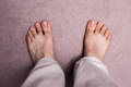Man s bare feet on carpet top view of a Royalty Free Stock Photo