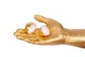 Man s golden hand holding eggshell isolated white background Royalty Free Stock Images