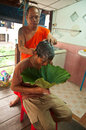 Man s hair who is going to be buddhist monkhood ang thong province thailand circa august an unidentified monk shaves on a Stock Image