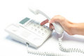 Man's hand dialing telephone keypad Royalty Free Stock Photo