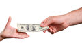 Man's hand gives a the bill 100 US dollars in a child's hand Royalty Free Stock Photo