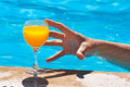 Man's hand and glass with orange juice Royalty Free Stock Photo