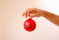 Man's hand holding Christmas ball  Stock Photography