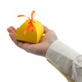 Man s hand holding gift paper box isolated white Stock Image