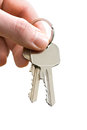 Man s hand holding house keys white background Stock Image