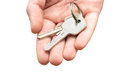 Man s hand holding house keys white background Royalty Free Stock Photo