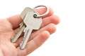 Man s hand holding house keys white background Royalty Free Stock Images