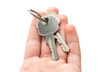 Man s hand holding house keys white background Royalty Free Stock Photos