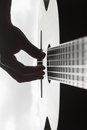 Man` s hand playing on classical guitar against a background of Royalty Free Stock Photo
