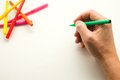 The man s hand ready to draw a picture felt tip pen Stock Photo