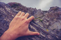 Man s hand on rock as he is climbing Stock Image