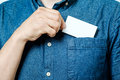 Man`s hand takes out blank business card from the pocket Royalty Free Stock Photo