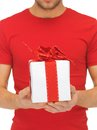 Man s hands holding gift box bright closeup picture of Stock Photos