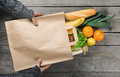 Man`s hands holding paper bag of groceries Royalty Free Stock Photo