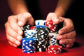 Man's hands move the winnings casino chips Royalty Free Stock Photo