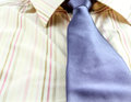 Man s shirt and blue tie background Stock Photo