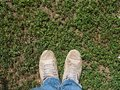 stock image of  A man`s two legs on a green field.