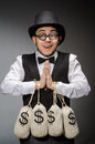 Man with sacks of money Royalty Free Stock Photos
