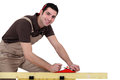 Man with a sander and pen Stock Photo