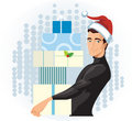 Man in a Santa hat with presents Stock Photo