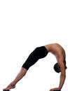 Man sarvangasana setu bandha bridge pose yoga caucasian gymnastic stretching bend isolated studio on white background Royalty Free Stock Images