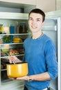 Man with saucepan  near refrigerator Royalty Free Stock Photo