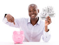 Man saving money in a piggybank happy isolated over white Royalty Free Stock Photo