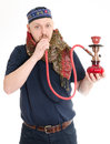 Man with scarf smoke waterpipe Stock Photos