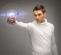 Man with sci fi weapon Stock Photography