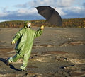 Man in scientific overalls with umbrella Stock Images