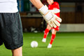 Man scoring a goal at indoor football or indoor soccer Stock Image