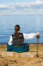 Man in scottish costume looking at the sea Royalty Free Stock Photos