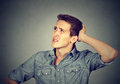 Man scratching head, thinking can`t remember looking up Royalty Free Stock Photo