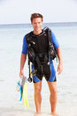 Man with scuba diving equipment enjoying beach holiday smiling to camera Royalty Free Stock Image